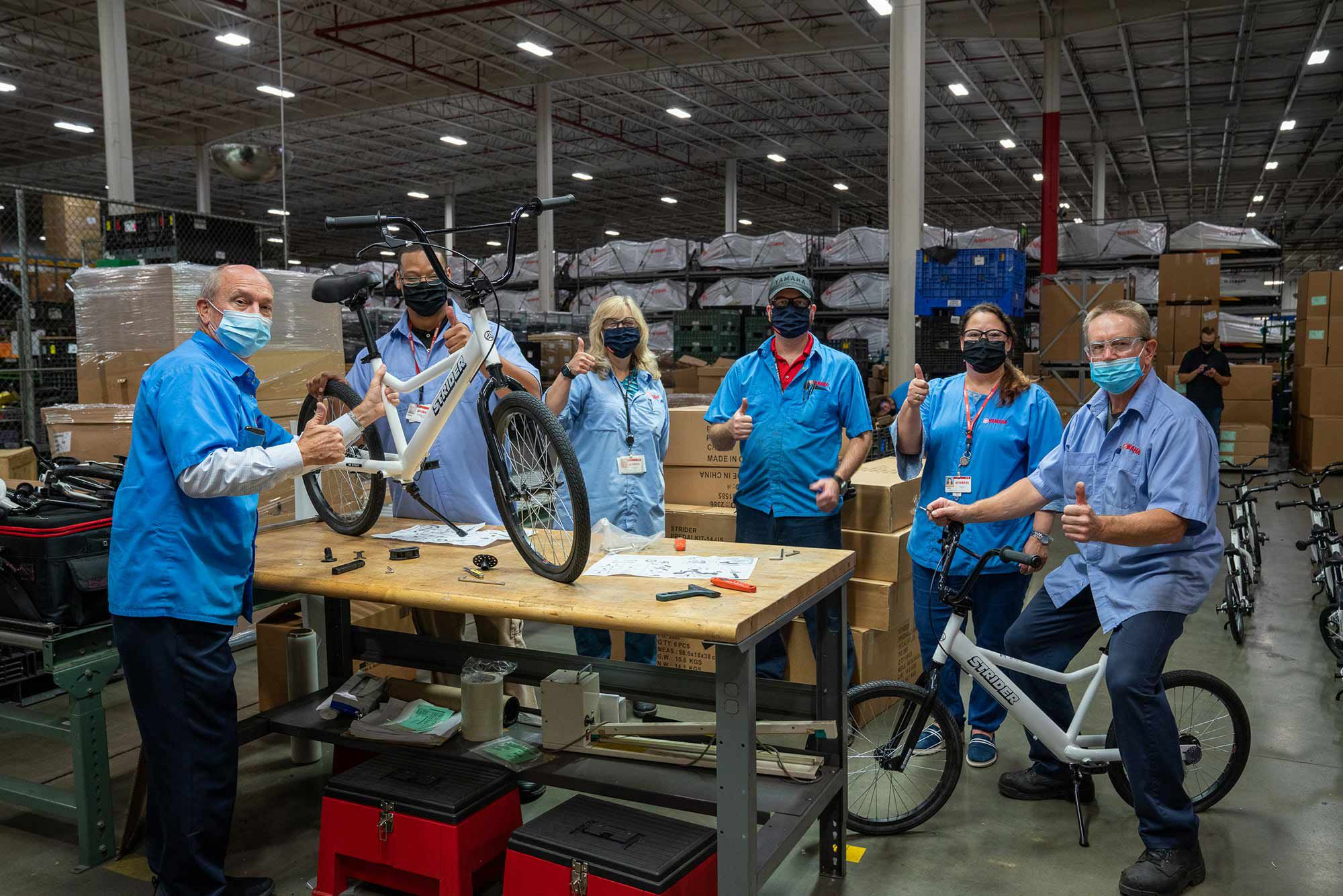 Yamaha employees donate their time to assemble and deliver bicycles to schools that have adopted the All Kids Bike program.